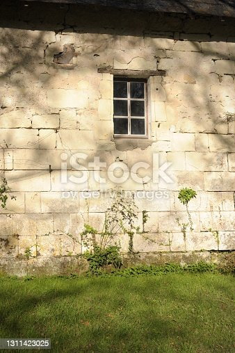 Small window and wall in tuf of a farmhouse in touraine