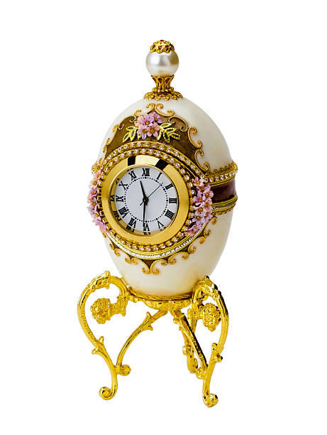 Faberge egg decorates clock isolated Decorative faberge egg a great gift isolated on white background fine art statue stock pictures, royalty-free photos & images