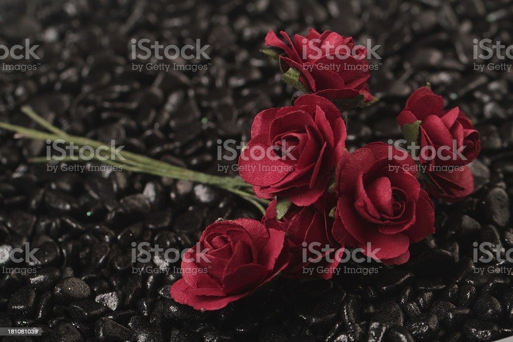fabric flowers on black stones royalty-free stock photo