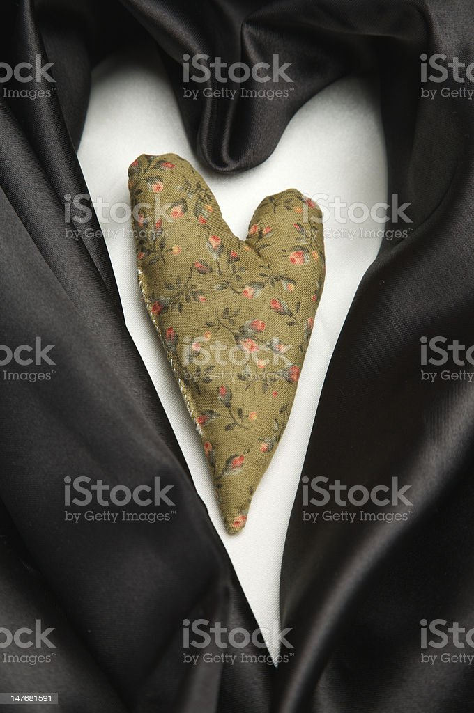 Fabric heart against a black and white background royalty-free stock photo