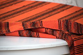 istock Fabric in traditional Southwestern style on a rough wood shelf in Old Town, San Diego 1326820650