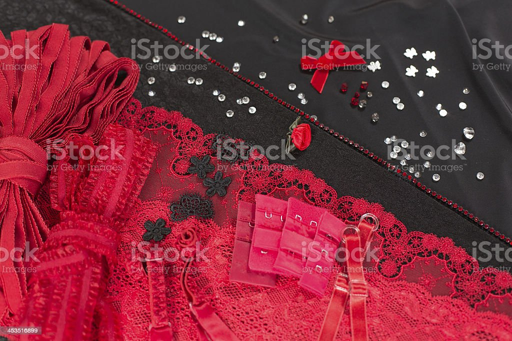 Fabric, lingerie tull and different sewing supplies royalty-free stock photo