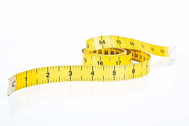Fabric measuring tape in yellow  stock photo