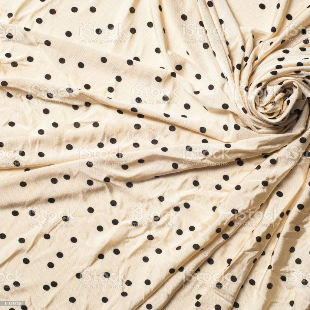 fabric of beige polka dots stock photo