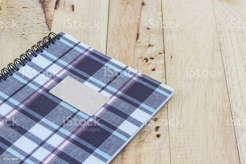 Fabric plaid texture cover spiral notebook. stock photo