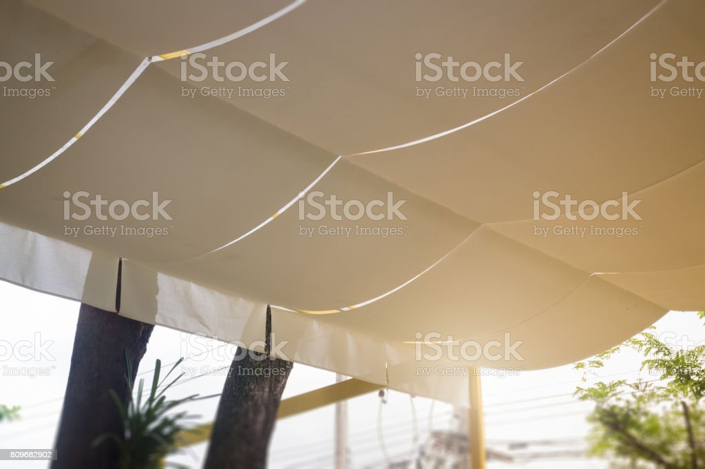 Fabric roof in the form of a beige tent stock photo