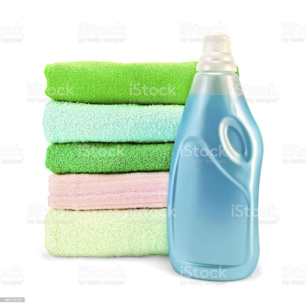Fabric softener the bottle and a stack of towels stock photo