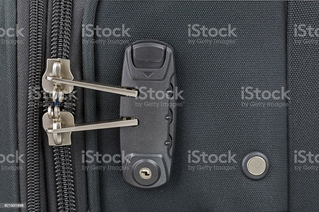 Fabric suitcase with built in luggage lock, new clean luggage stock photo