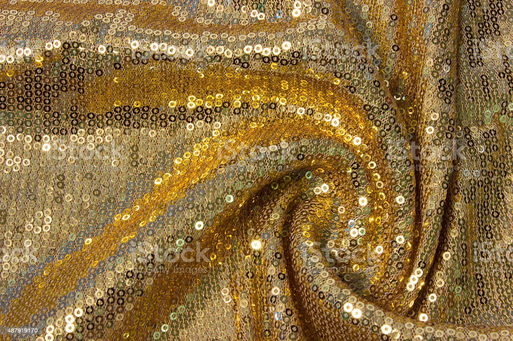 fabric texture with reflective gold rings with pleats stock photo