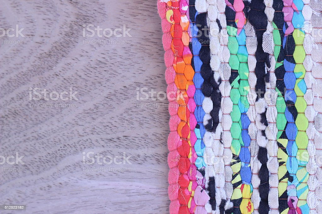 Fabric with beautiful pattern on brown wood stock photo