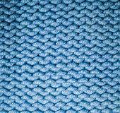 blue fabric woolen yarn texture. background, craftsmanship.