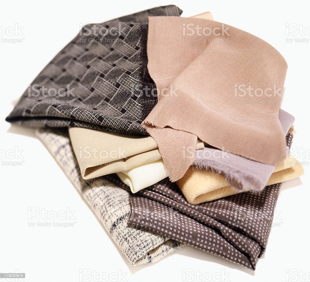 fabrics in a pile cut out on white royalty-free stock photo
