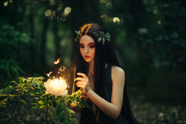 a fabulous, forest nymph with long hair - romantic moon stock photos and pictures