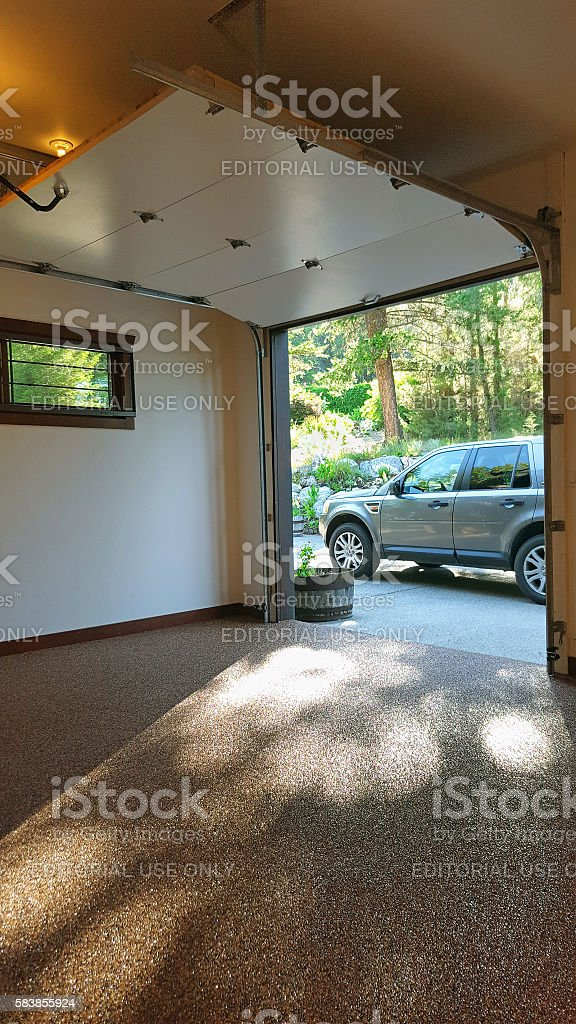 Fabulous Garage Interior With SUV Outside stock photo