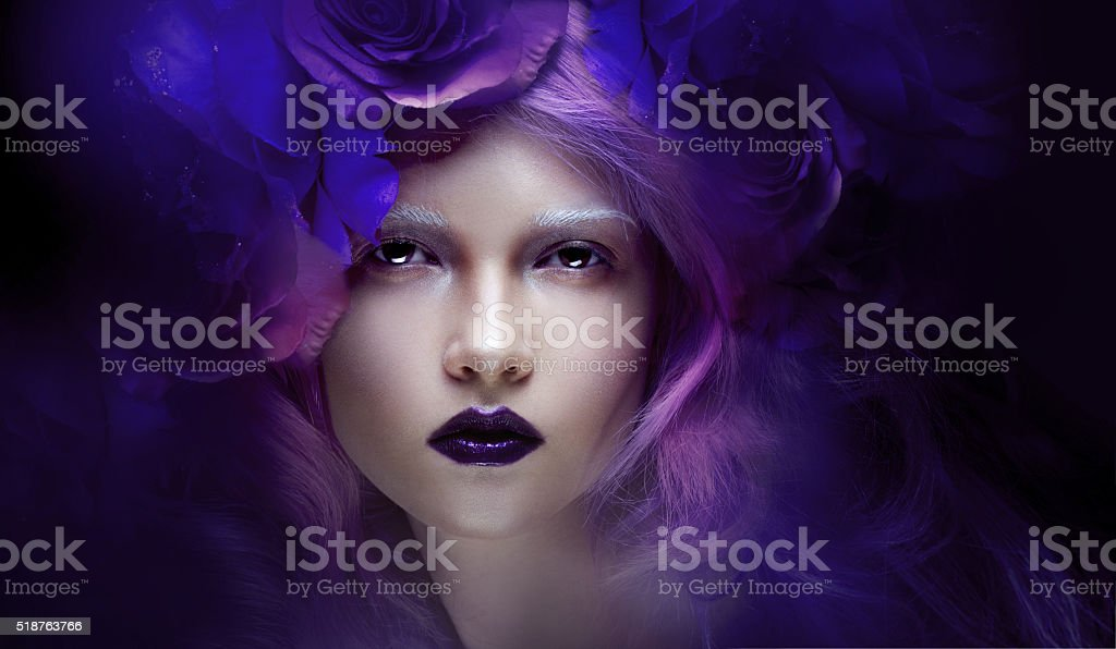 fabulous girl with blue hair. Portrait in a wreath of stock photo