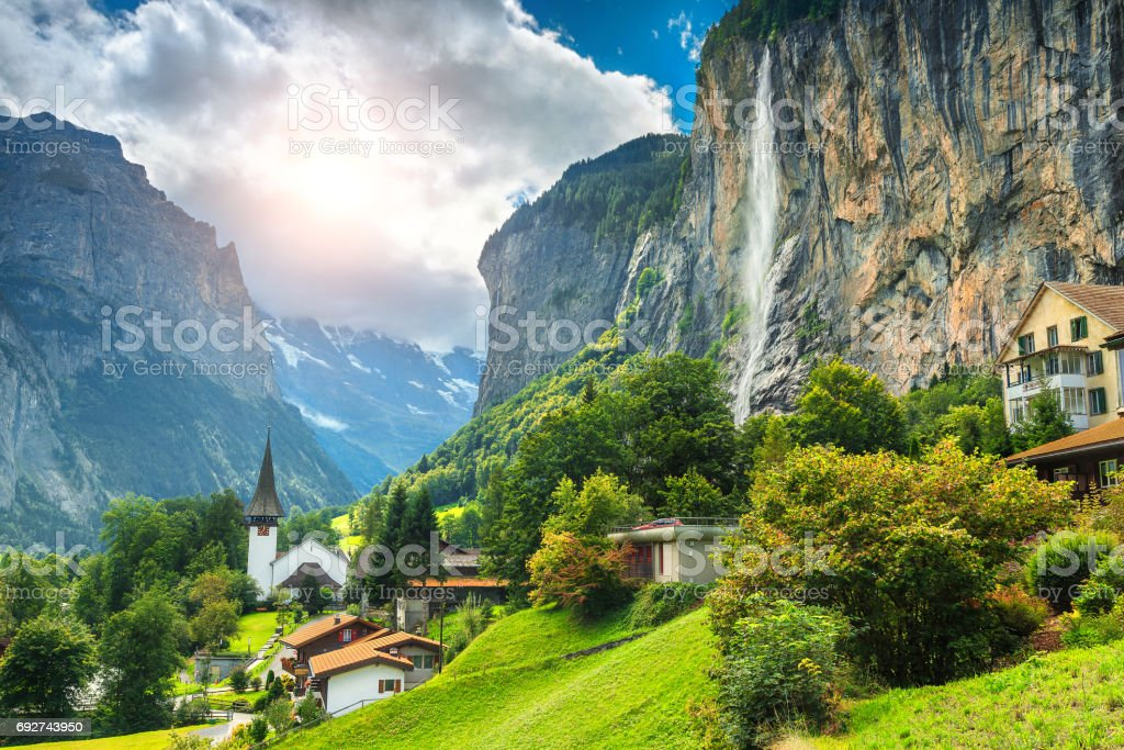 Fabulous mountain village with high cliffs and waterfalls, Lauterbrunnen, Switzerland stock photo