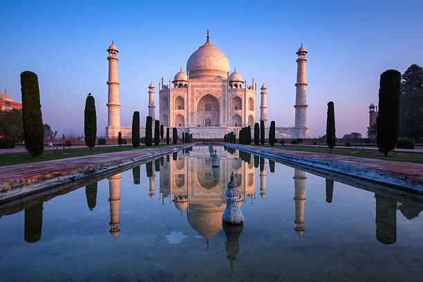 Fabulous Taj Mahal. Taj Mahal refelct in sunrise colors. taj mahal stock pictures, royalty-free photos & images