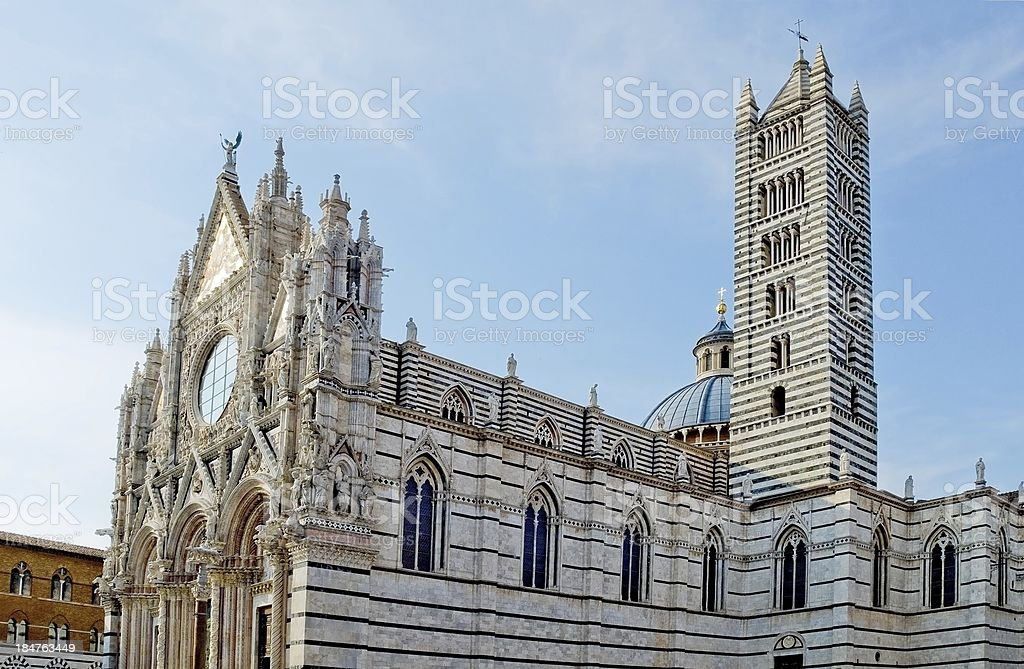 Facade and belfry of the Siena Cathedral in Opera royalty-free stock photo