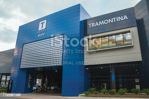 Carlos Barbosa, Brazil - July 12, 2019. Facade and parking gate at Tramontina Factory Store building, a company that manufactures cookware, cutlery and home appliances headquartered in Carlos Barbosa.