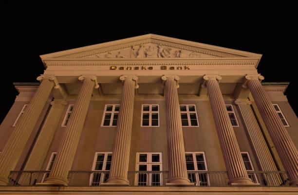 Facade at night of the danish bank in copenhagen with big columns in picture id1056025602?b=1&k=6&m=1056025602&s=612x612&w=0&h=cbz6cpymwez1yucgwa2l1sj7uf7zstguzla9ub5gkyy=
