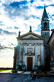 church facade with bell tower in the hills around Castegnero, Vicenza, Veneto, Italy