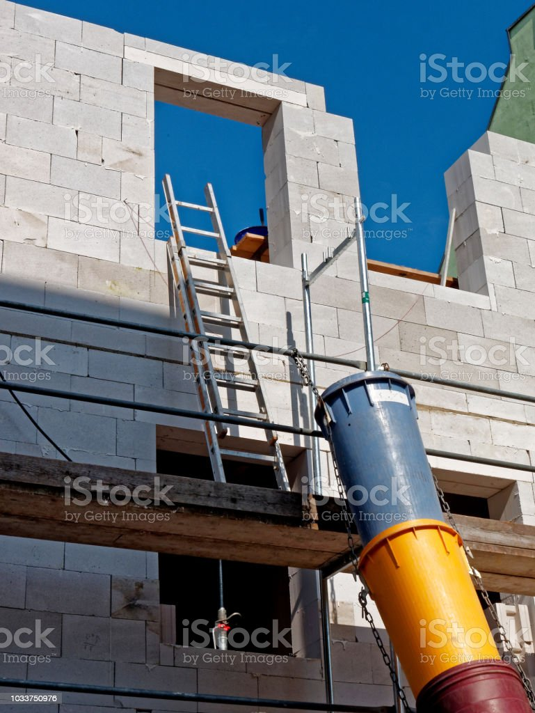 facade construction site - building rubble slide stock photo
