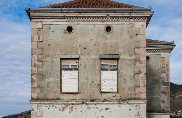 Facade in Mostar featuring scars of the Bosnian war stock photo