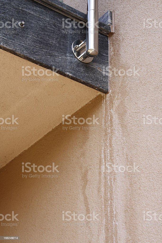 Facade moisture from the balcony stock photo