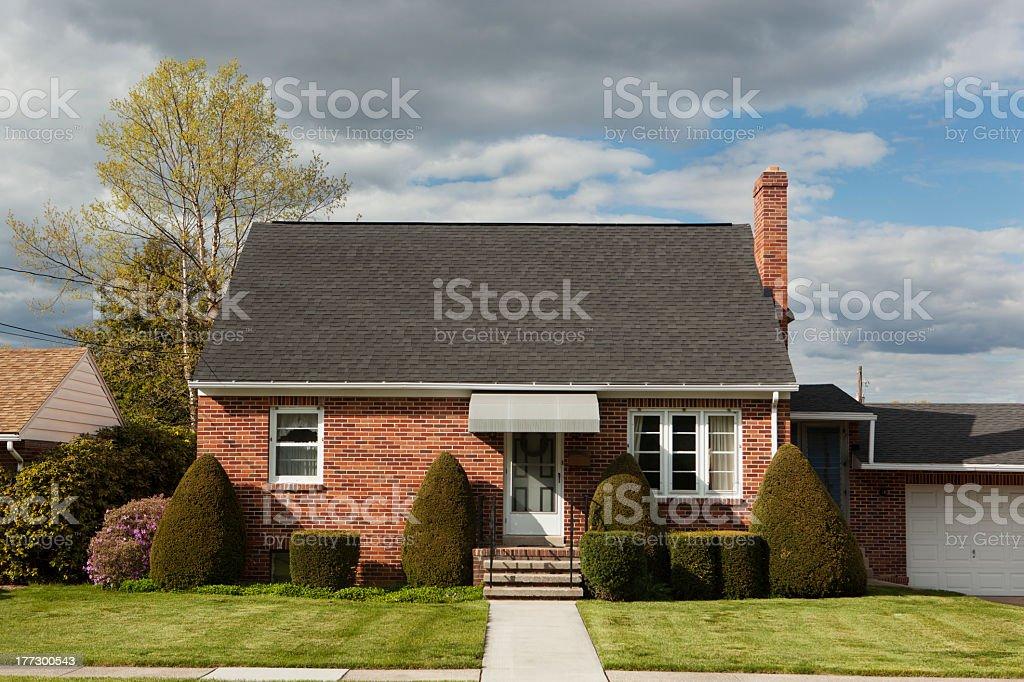 Facade of a brick bungalow stock photo
