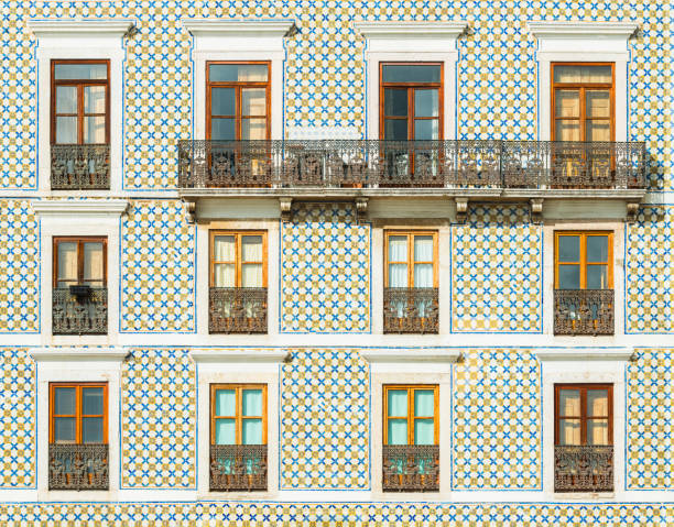Facade of a building covered with traditional Portuguese tiles. Typical building decoration in Lisbon, Portugal stock photo