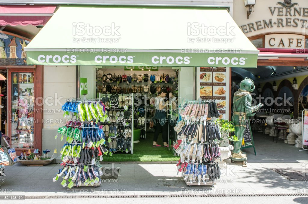 602751098fc4e3 Facade of a Crocs shoe store in Budapest during summer day - Stock image .