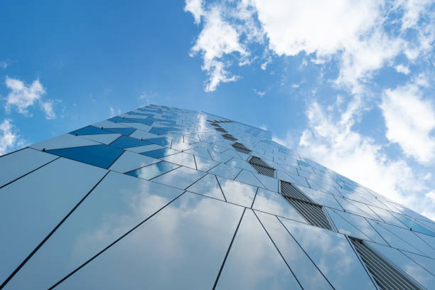 Facade of a glass building. Cloudy sky Bottom view. Close-up. Architecture. Copenhagen. Denmark. July 24th. 2019: Facade of a glass building. Cloudy sky Bottom view. Close-up. Architecture Backgrounds brics stock pictures, royalty-free photos & images