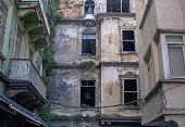 istock Facade of a grungy abandoned urban house 1256009891
