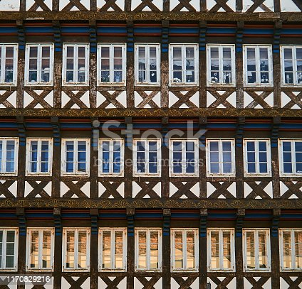 Facade of a half-timbered house in which all infills are taken up by windows.