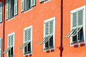 Facade of a house in the old town of Nice. Windows with shutters. French Riviera, Nice, France
