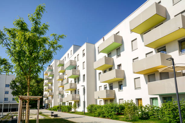 Facade of a modern apartment building in the city Facade of a modern apartment building in the city public housing stock pictures, royalty-free photos & images
