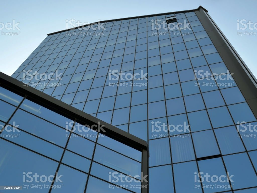 Facade Of A Modern Office Building Made Of Glass And Concrete With ...