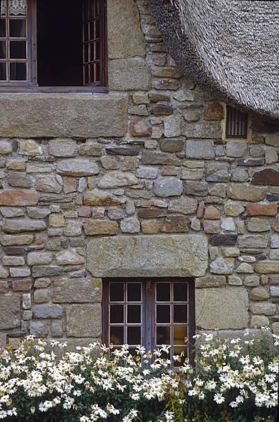 facade of a normandy country house - hobbit häuser stock-fotos und bilder