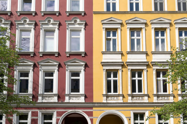 facade of a red and yellow house in Berlin Kreuzberg stock photo