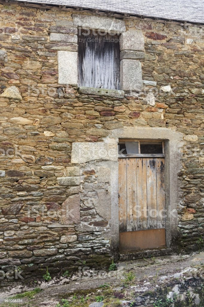 Facade of abandoned  ruins of an old rural fisherman house in Doelean, Brittany, France stock photo