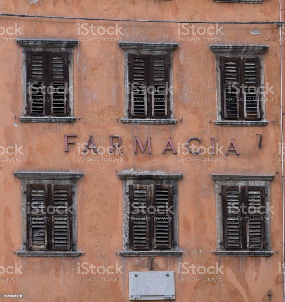 Facade of an old farmacy building in Trento stock photo