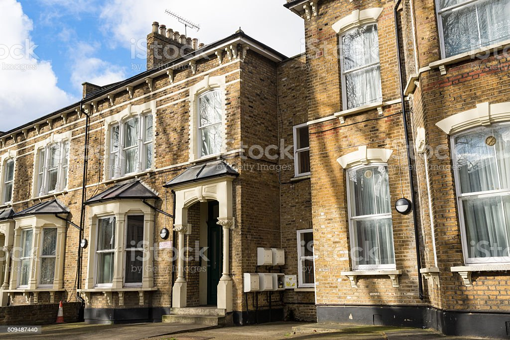 Facade of British Victorian family houses stock photo