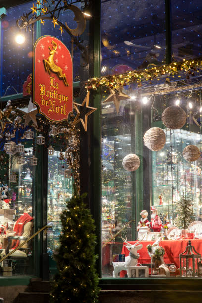 Facade of Christmas store at night in historic district of Quebec City