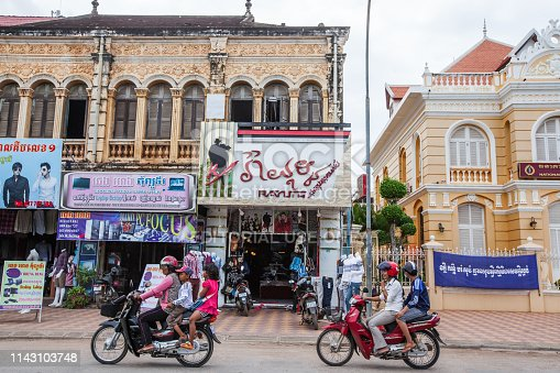 Battambang, Cambodia - SEPTEMBER 21, 2013: Old and new, scenic landscape capital city of Battambang, gorgeous french colonial building, brand new fashion clothes store and National Bank of Cambodia. Battambang.