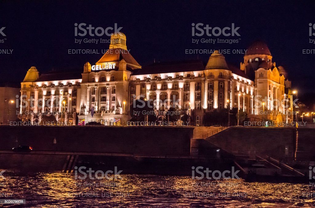 Facade of Gellert Hotel and thermal bath seen from other side of Danube river during summer night stock photo