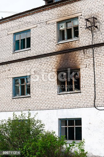 istock Facade of highrise house after an explosion and fire 599711314