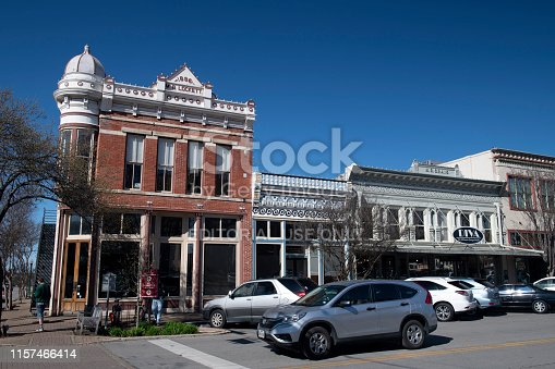 Georgetown, USA - March 13, 2019. Facade of historic buildings in downtown of Georgetown, Texas, with people on sidewalk.