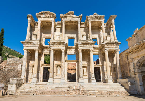 Facade of Library of Celsus in Ephesus, Turkey The Library of Celsus is an ancient Roman building in Ephesus, Turkey. It was built in honour of the Roman Senator Tiberius Julius Celsus Polemaeanus and completed between 114–117AD. celsus library stock pictures, royalty-free photos & images