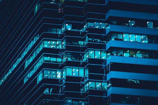 Facade of modern building at night