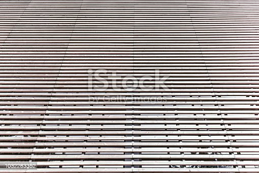 istock Facade of modern building made of parallel timber battens 1032283352